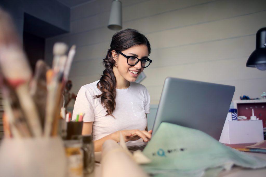 Webinar Statistics - Woman Using her Laptop